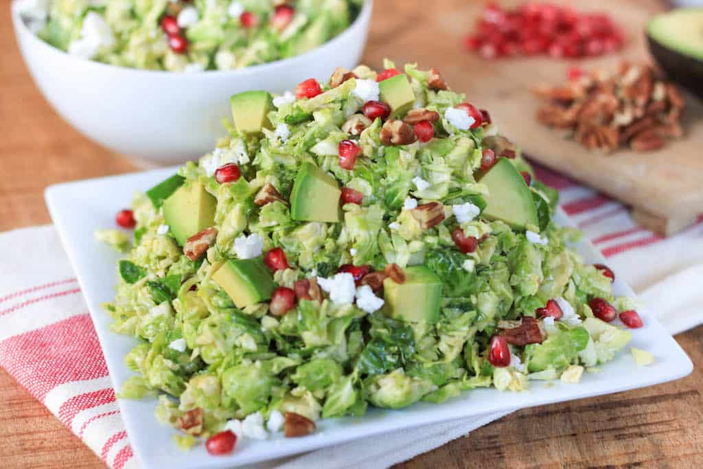 Shredded Brussels Sprout and Pomegranate Salad with Honey Mustard Vinaigrette