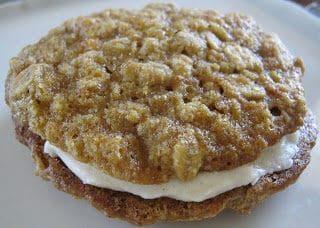 carrot cake sandwich cookies with cinnamon maple cream cheese frosting