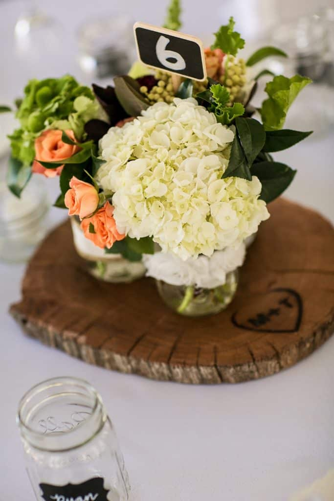 Wedding Images - Wedding Table Number Six with a Bouquet of Flowers on Top