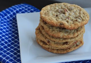 Oatmeal Coconut and Cinnamon Chip Cookies stacked on a white plate