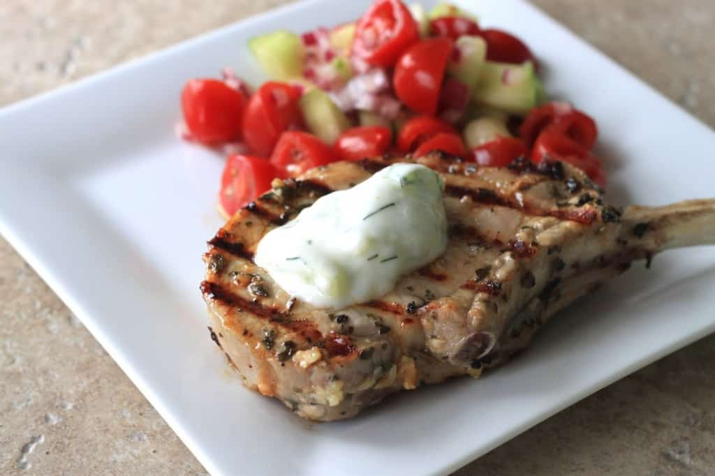 greens & chocolate: greek pork chops with tomato and cucumber salad