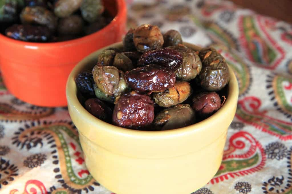 Citrus and Rosemary Roasted Olives Closeup on Two Cute Bowls