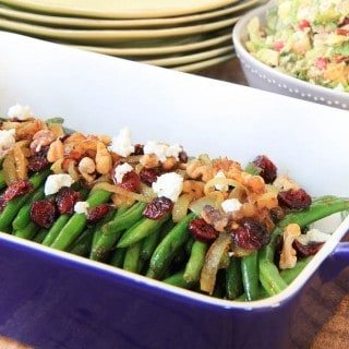 Brown Sugar Glazed Green Beans with Caramelized Onions, Cranberries, Walnuts and Goat Cheese Closeup Shot