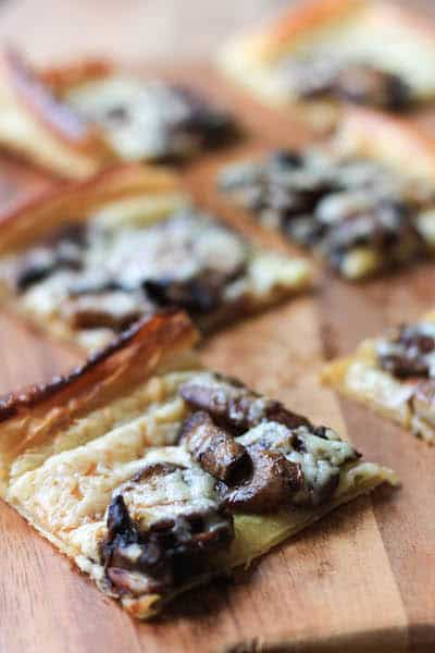 Mushroom Havarti Flatbread on the Wooden Board Cut in Square Bites