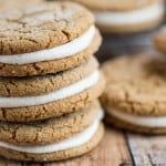 Fantastic Ginger Molasses Sandwich Cookies with Eggnog Buttercream stacked in a yummy tower of three