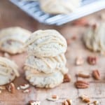 Butter Pecan Maple Cookies stacked on top of each other on the table