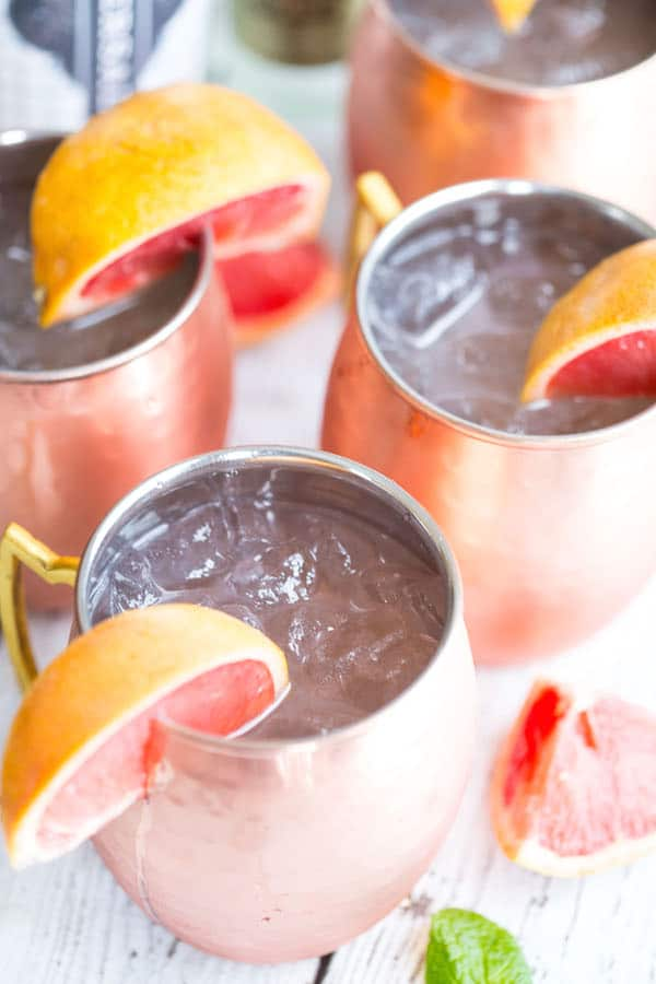 Grapefruit Moscow Mules - Four Jars with Grapefruit Pieces All Over