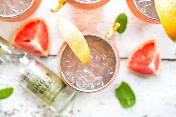 Grapefruit Moscow Mules - Overhead with a Ginger Beer Bottle and Grapefruit Pieces