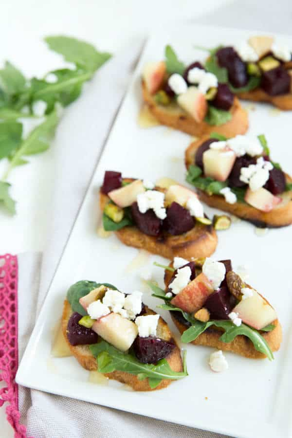 Grilled Apple Beet and Arugula Crostini