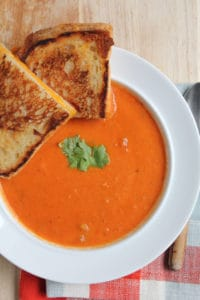 Butternut Squash and Roasted Red Pepper Soup in a White Bowl on the Table
