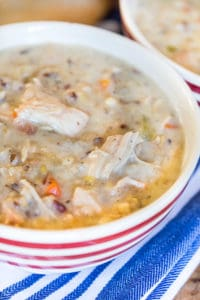 Slow Cooker Turkey Wild Rice Soup in a Bowl on the White Blue Towel