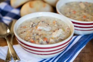 Slow Cooker Creamy Turkey Wild Rice Soup in Two Bowls with Two Spoons