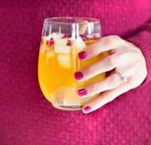 Apple Cider Bourbon Sangria - Holding in the Hand a Full Glass