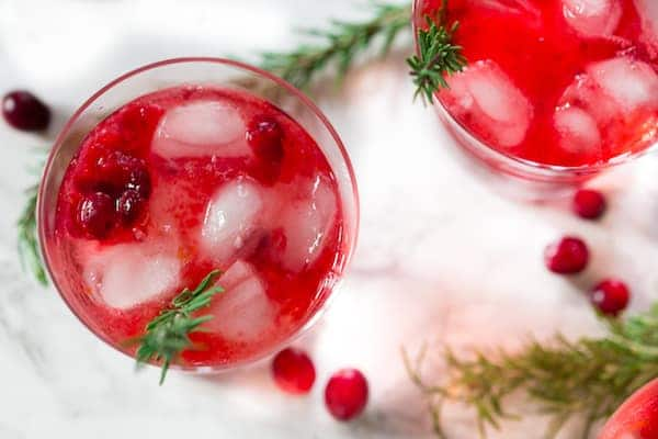 Cranberry Sauce Vodka Smash Colorful Glasses with Cranberry Berries On the Table