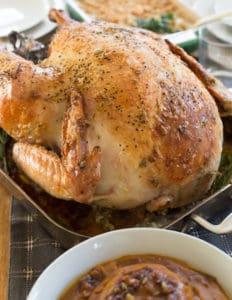 Garlic and Herb Mayonnaise Roasted Turkey with Side and Stuffing on the Table