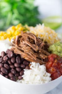 Slow Cooker Barbacoa Beef Burrito Bowls - Focus and Closeup on the Meal in a White Bowl