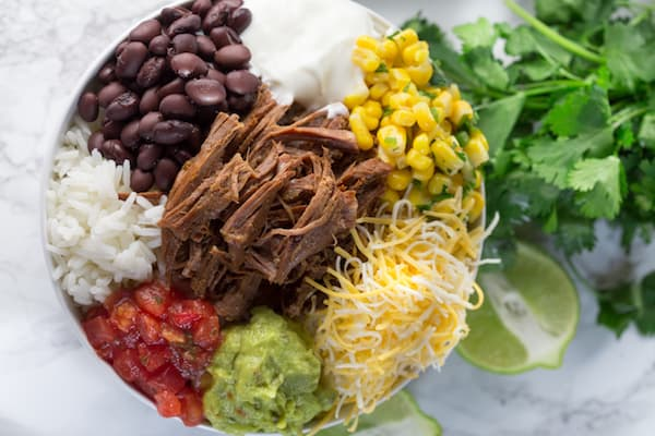 Slow Cooker Barbacoa Beef Burrito Bowls - Shot from the Top on the Bowl on the Table