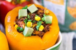 Mexican Chicken and Quinoa Stuffed Peppers Major Closeup on the Mouthwatering Ingredients of the Yellow Pepper