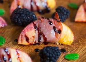 Grilled Prosciutto Wrapped Peaches with Blackberry Balsamic Glaze