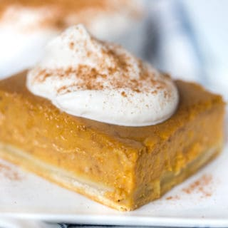 Pumpkin Pie Bars with Maple Whipped Cream Beautifully Served in a Cute Little White Plate
