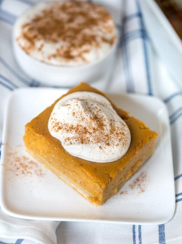 Pumpkin Pie Bars with Maple Whipped Cream on a Towel