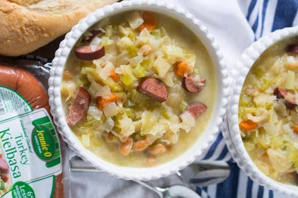 Slow Cooker Kielbasa and Cabbage Soup Overhead on Two Bowls of Soup and Jennie-O Turkey Kielbasa