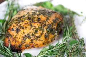 Herb Butter Roasted Turkey Breast Closeup with Herbs on the Plate