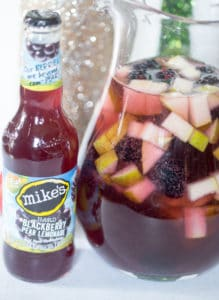 Spiced Blackberry Pear Sangria in a Jar and a Bottle Next to It