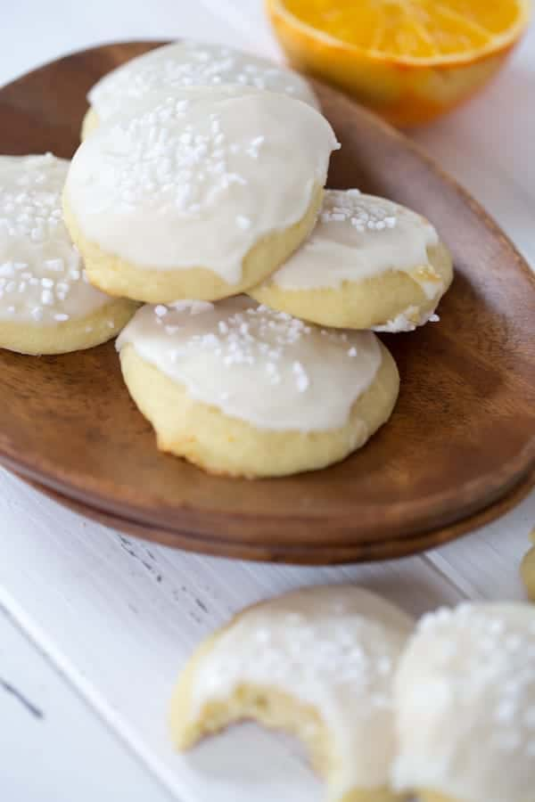 A small tower of the Orange Almond Ricotta Cookies with even more cookies blurred in the foreground