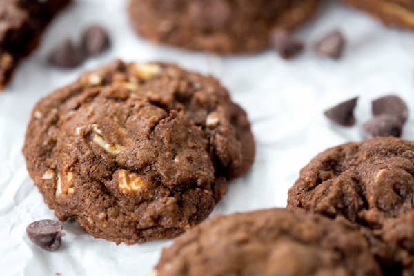 One of the Triple Chocolate Cookies is in focus with others - blurred in the background