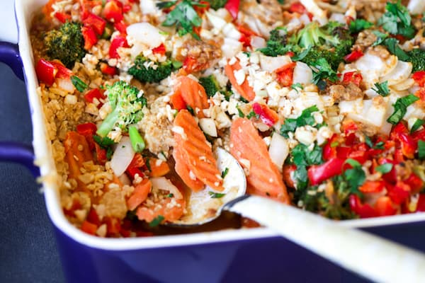 Thai Peanut Chicken Quinoa Casserole Closeup with a Spoon Inside