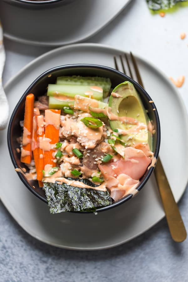 Tuna Rice Bowls with Yum Yum Sauce in a Bowl on the Plate with a Fork Next to It