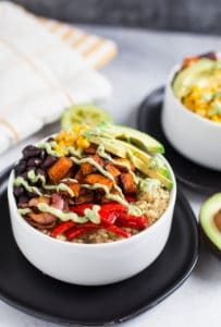 Vegetarian Quinoa Burrito Bowls with Avocado Cream Sauce Beautiful Closeup on the Served Bowl of The Incredible Delicious Meal