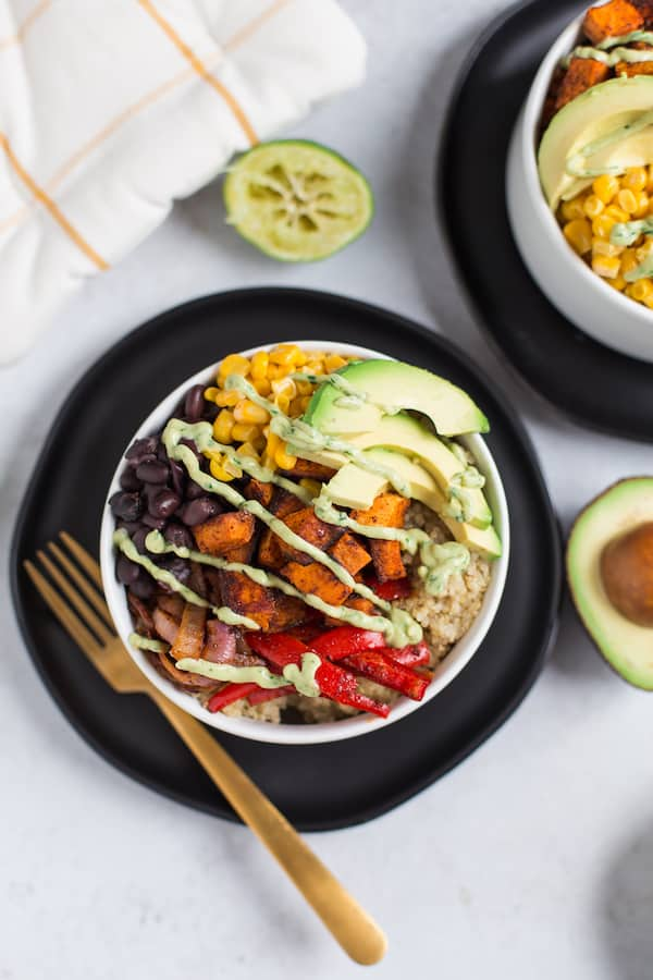 Vegetarian Quinoa Burrito Bowls with Avocado Cream Sauce Beautiful Closeup on the Served Bowl of The Incredibly Delicious Meal